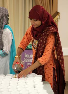 Sana Ullah pours drinks in preparation for iftar at her mosque in Pembroke Pines. During Ramadan, Muslims fast from eating and drinking from sunrise to sunset.