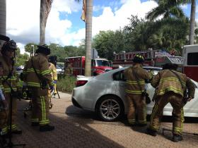 Firefighters demonstrate how they respond to calls of children left in hot cars.