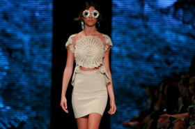 IN THE SUN: Apparel from Peru's Escudo line on the runway at Miami Fashion Week in May.