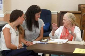 Rachel Schapiro, (left) and Hinda Adle, (center) interview Rita Grossman, (right) at a JCS meal site on South Beach. Rachel, and Hinda, are part of a group of young professionals, called the Jewish Community Services Alliance, interviewing seniors. The group is hoping to raise $18,000 by September to receive a $165,000 grant from Florida's Department of Transportation.