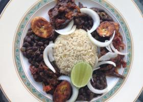 A plate of Vaca Frita with rice and fried plantains
