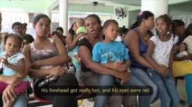 MOMS VS MOSQUITOES: Haitian mothers and children await treatment for chikungunya symptoms in a PAHO information campaign