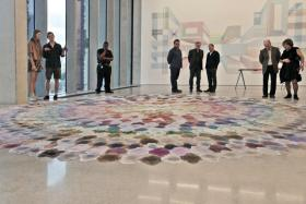"Art lovers gather around the piece ""Mojo Jojo"" in the Pérez Art Museum Miami in December."