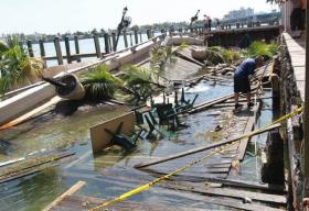 Debris floats in the bay next to Shuckers in June 2013.