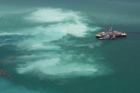 Biscayne Bay Waterkeeper claims the ships working for U.S. Army Corps of Engineers are leaking sediment which harms coral reefs near the dredging project. The group says this image was taken on June 25, 2014.