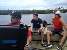 Ivan Bertaska, Anderson Lebadd and Edoardo Sarda run their robotic boat through the motions on the Intracoastal Waterway near Dania Beach.