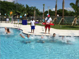 South Miami Mayor Philip Stoddard makes the first jump into the new pool.