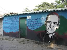 Archbishop Oscar Romero's image on the wall of a home in El Salvador.
