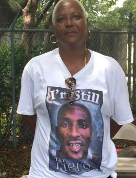 VIcky Hemingway wears a memorial t-shirt of her son Larry Valentine at a Liberty City anti-violence protest.  He was 23 when he was murdered in front of their home.