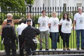 Protesters handcuff themselves to the White House fence in 2010 tin protest of the Don't Ask Don't Tell policy.