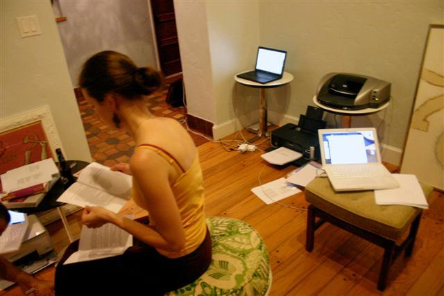 Nicole Bugeau looks over a copy of 3-Cent Journal, as other copies print in the background.