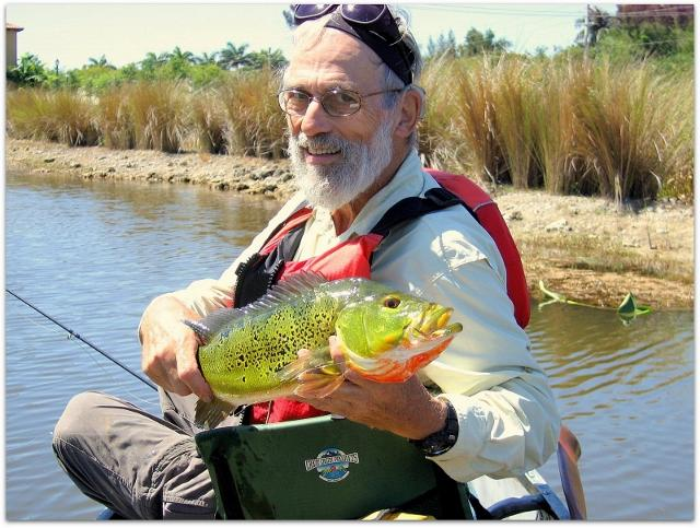 Arnold Markowitz and a butterfly peacock he caught in a Broward canal.