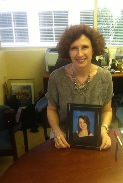 Susan Holtzman with a photo of her daughter, Elise.