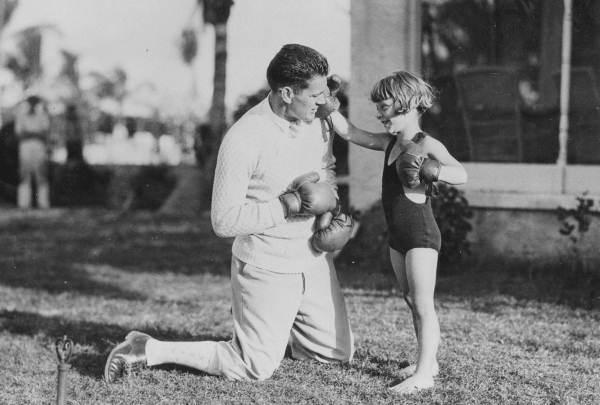 "Jackie Ott, ""the Aqua Tot,"" socks heavyweight champion Gene Tunney in Coral Gables in 1924."