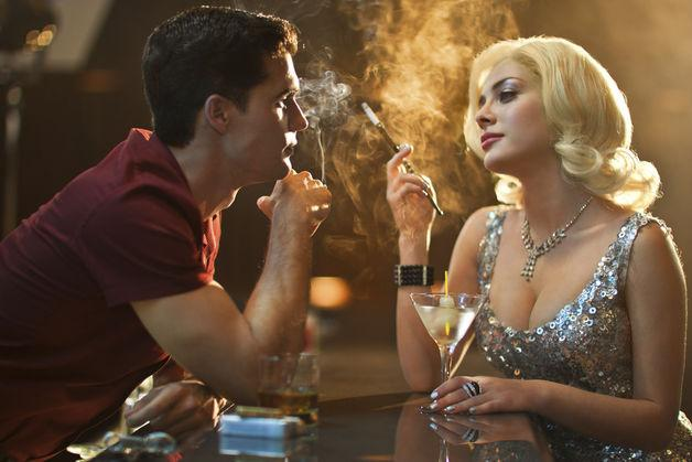 "Steven Strait and Elena Satine in ""Magic City."""