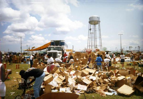 Displaced people look through boxes of aid after Hurricane Andrew.