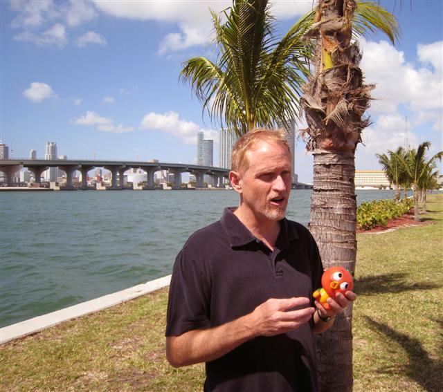 "Campbell McGrath holds the ""Florida orange bird."""