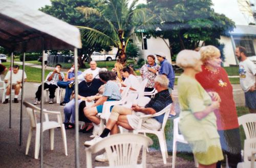 Barbecues are dragged out to the cul-de-sac for the fifth anniversary of Hurricane Andrew.