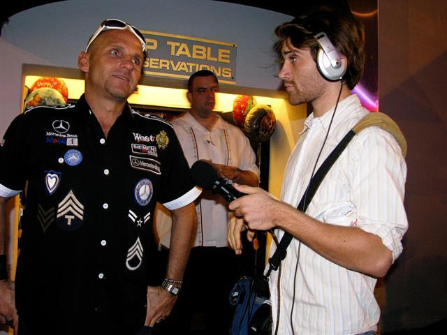 Kenny Malone with Alan T in front of the Club Space VIP door. Kenny wears the questionable outfit mentioned in the piece.