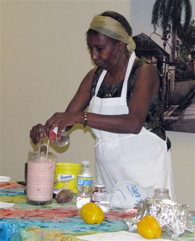 Louis pouring evaporated milk to make Haitian juice.