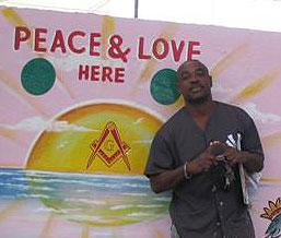 Toussaint stands in front of one of his latest murals.