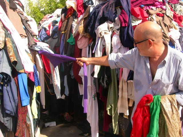 Neraldo de la Paz pulls out garments he will use, including the green pantyhose.