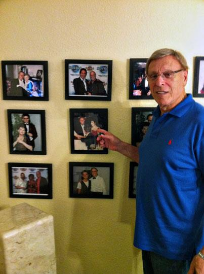 Real estate mogul Tony Dee and his wall of photos. He points to one of him and Eartha Kitt.