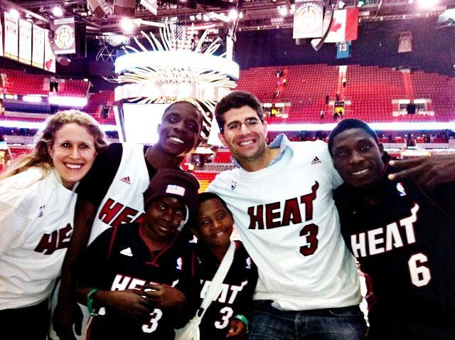 Chad and Brooke Perlyn with Peterson Exais and friends at a Miami Heat game in 2011.