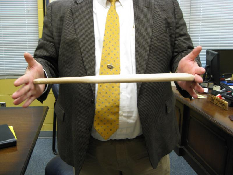 Holmes County High School principal Eddie Dixson holds the wooden paddle used to spank misbehaving high school students.