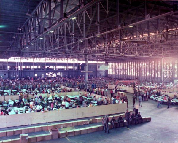 Cuban refugees from the Mariel boatlift are temporarily housed in a seaplane hanger in Key West.