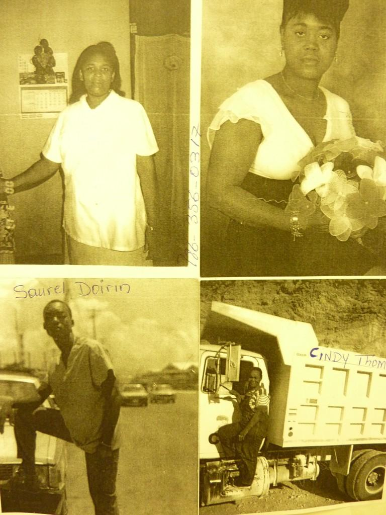 Pictures of missing loved ones on a board at the Haitian Relief Information Center.