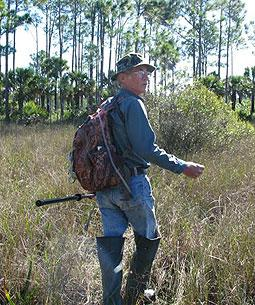 Frank Denninger walks through the grass of Big Cypress.