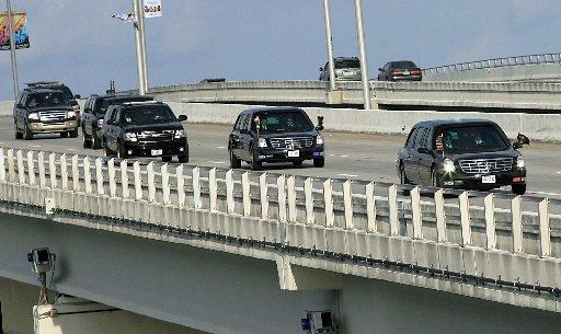 Here He Comes Again: A presidential motorcade much like this one that tied up Miami traffic in 2010 will inject itself into the Brickell area rush hour today.