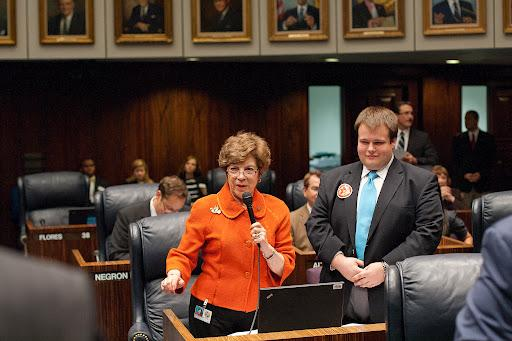 State Sen. Nan Rich wants state officials to end their argument over foreclosure money.