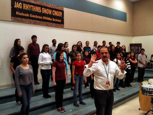 Salsa trumpeter and music teacher, Mario Ortiz, demonstrates salsa steps to his class at Hialeah Gardens Middle School.