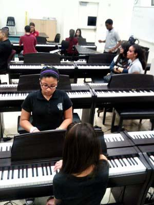 Students in Mario Ortiz's music class at Hialeah Gardens Middle School. Eighth grader  Jonathan Garcia, plays xylophone in the back.