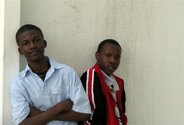 James Celestin and Michel Philco pose for one of their classmates.