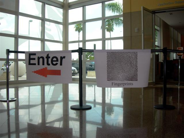 A sign directs applicants to the fingerprinting area at the United States Citizenship and Immigration Services building.