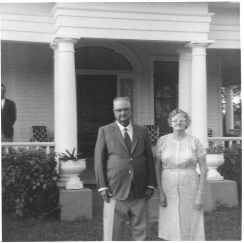 William and Sarah McDougald standing in front of the house, ca. 1960s.