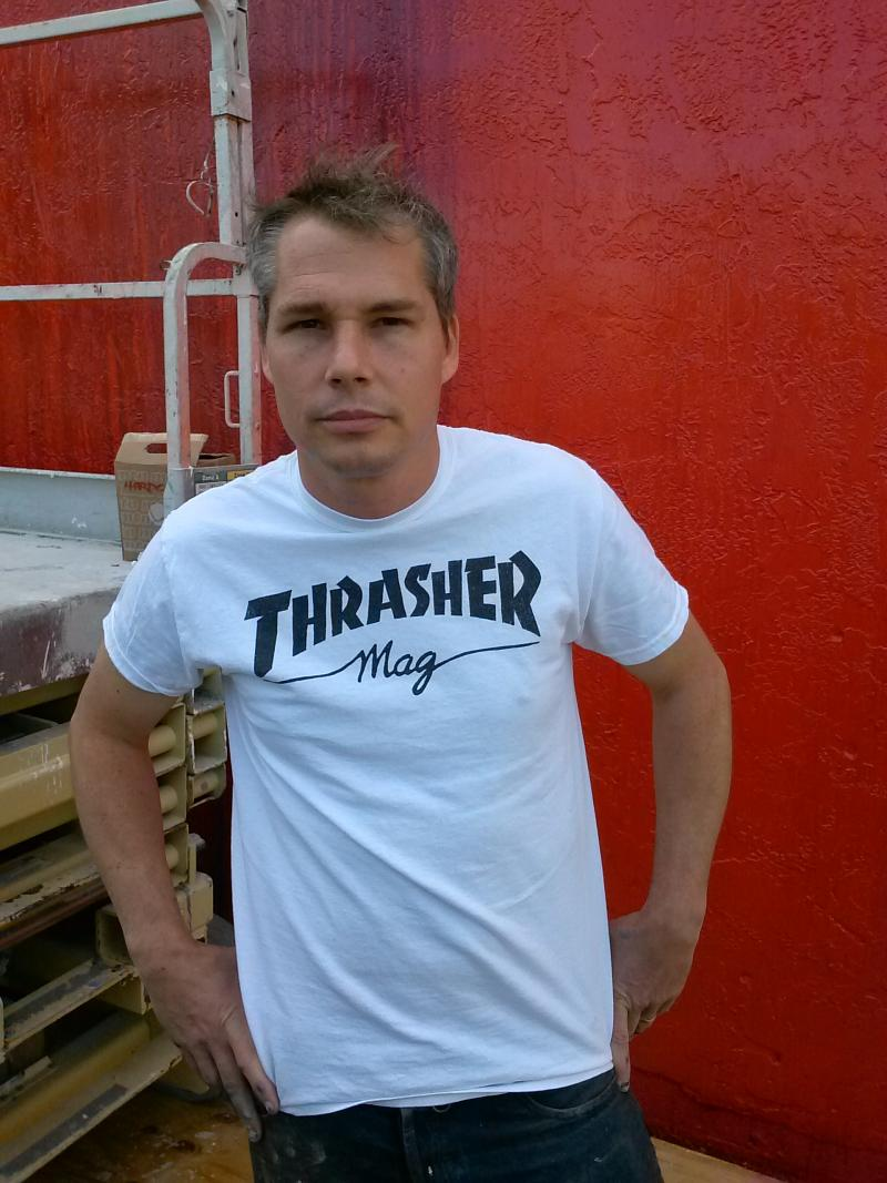 Shepard Fairey in front of the wall he is working on