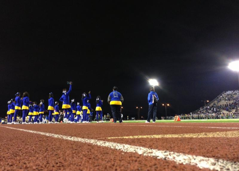 "Miami Northwestern's cheerleading squad sporting their school's unique colors: ""Old Gold & Royal Blue."""