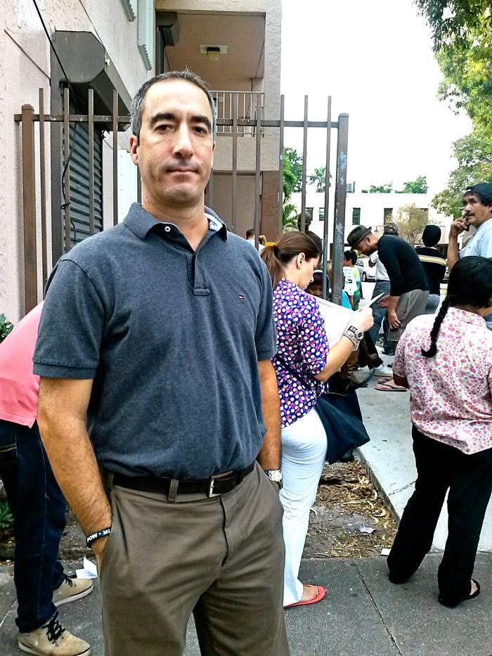 "Pedro Wasserman finally gets to cast his vote in Wynwood. He estimates that it has taken him about 18 hours over the past few days to vote.  ""It's a disgrace, really,"" he added."
