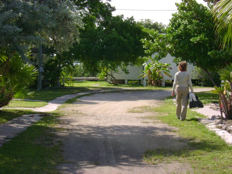 Riet is walking down the dirt road that the workers call Main Street. Many of the workers came from New York City and named the small alleys on the key after the streets they knew in NYC. There was also a Broadway and 41st Street.