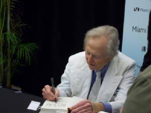 Tom Wolfe signs Jan Becker's books at the book fair on Sunday.
