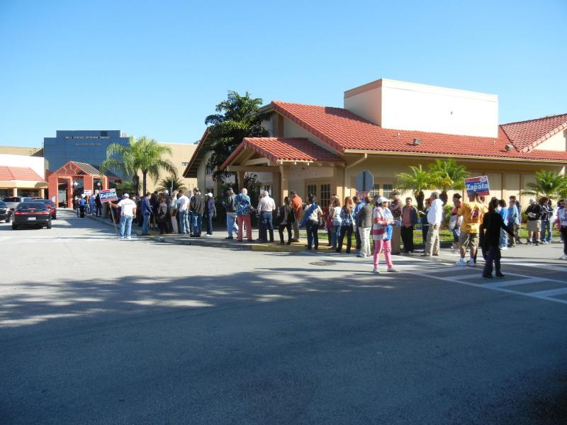 Early voters wrap around the corner of the West Kendall Regional Library