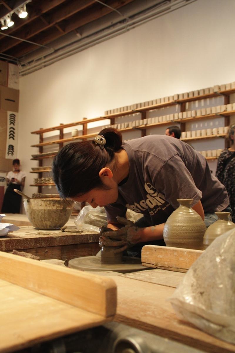 Yoko Fukuta is shaping a bowl.