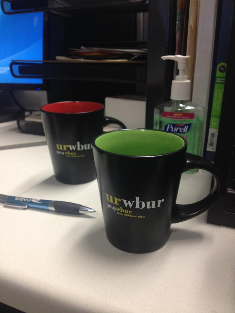 Our News Director Dan Grech, ladies and gentlemen. With not one... but two WBUR Boston coffee mugs. Seriously? What's up what this, Dan?