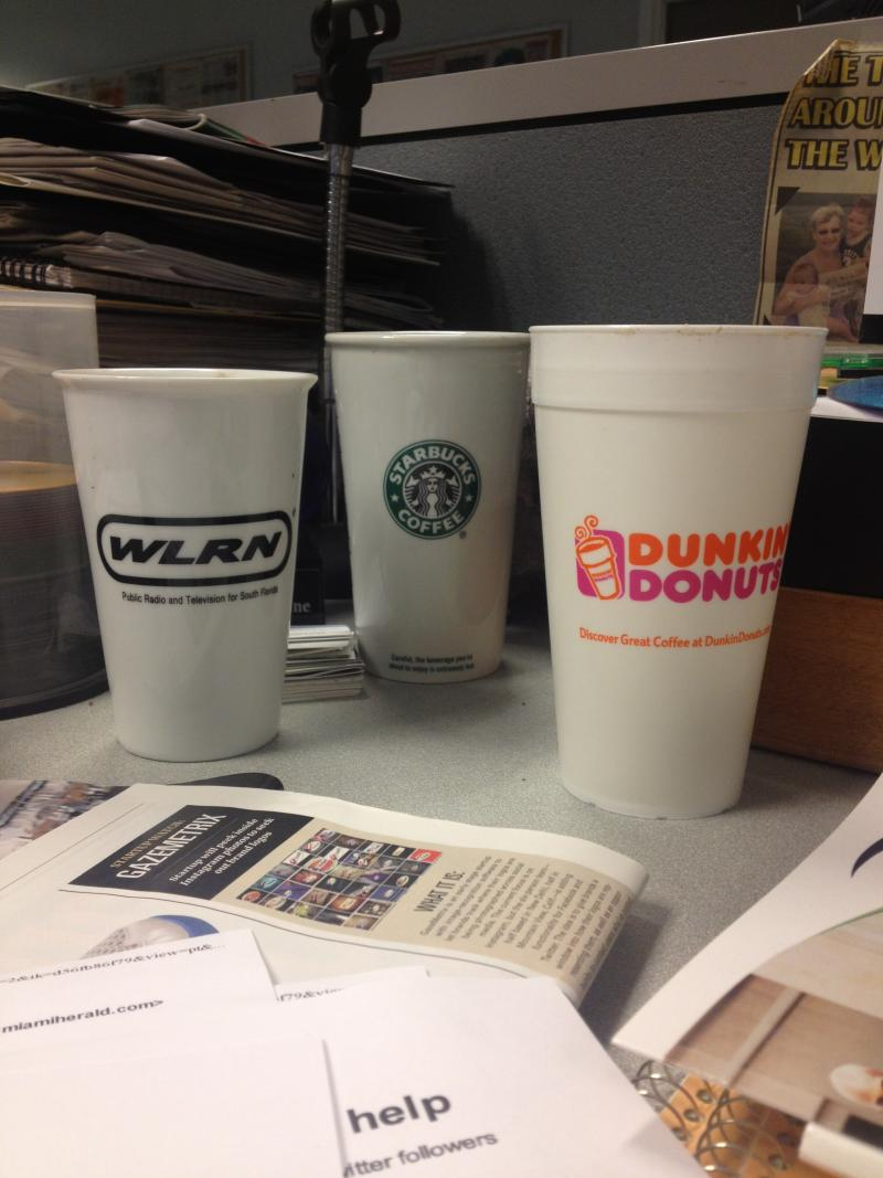 Reporter Kenny Malone. Those look like tree-killing disposable cups, but look closer. They're environmentally friendly reusable mugs. Kenny cares a lot more than he lets on. Also, he brings us Dunkin' Donuts all the time.