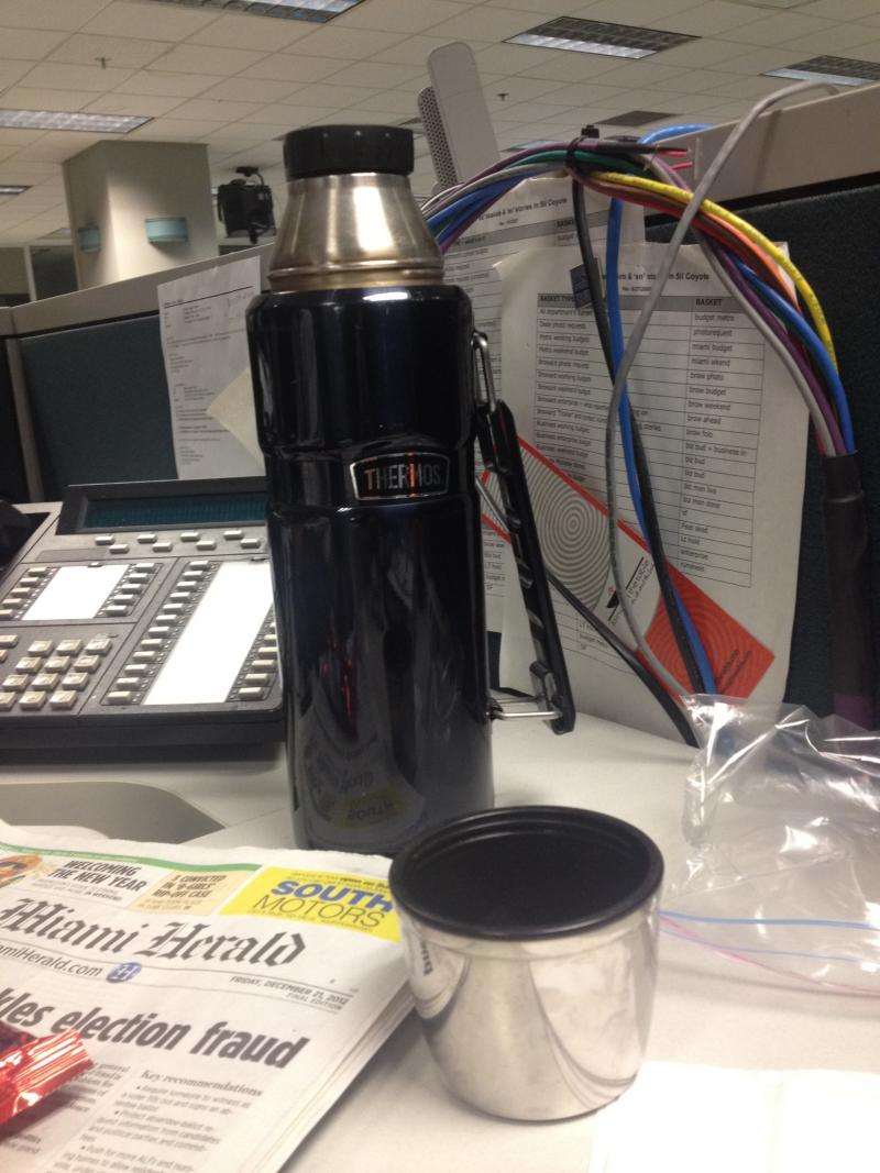 Morning Anchor/Reporter Phil Latzman, with a thermos full of coffee every morning. No coffee mug needed. The man is prepared. When you start your shift this early, you have to be efficient.
