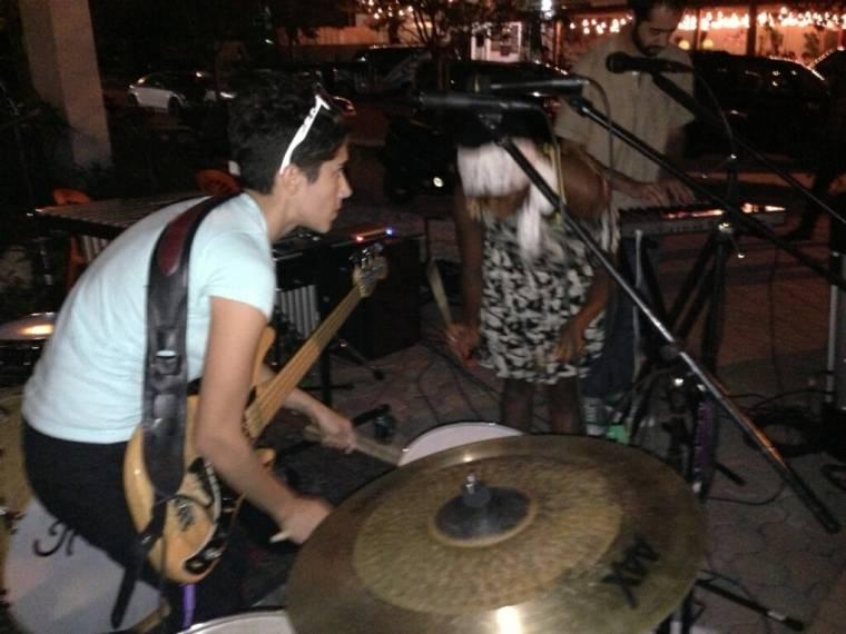 Bells rocking out with a percussion showdown at a Pop-Up Piano Miami perfomance at Jimmy'z Kitchen
